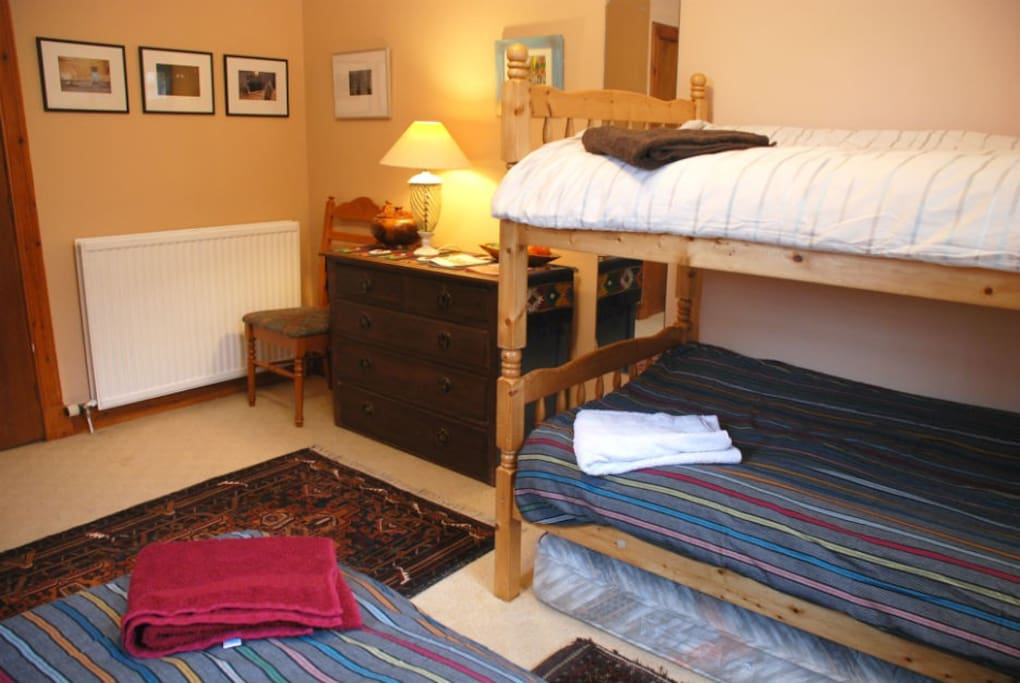 Newly redecorated bedroom; photographs by your host, David; Belouch Afghan rug on floor