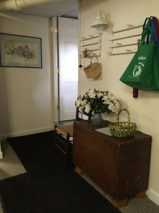 We share the entrance area into the apartment, which you see here.  Bags for nearby shopping hang ready for you.