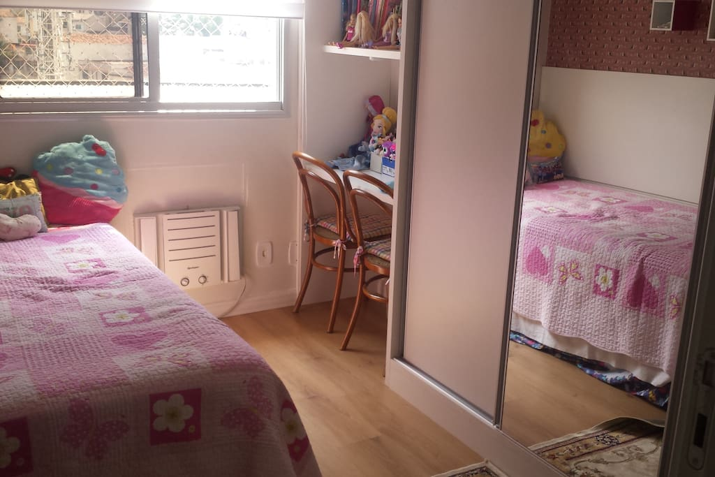 One of the bedrooms. Has air conditioner and double bed.