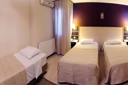 a triple room - Denizli