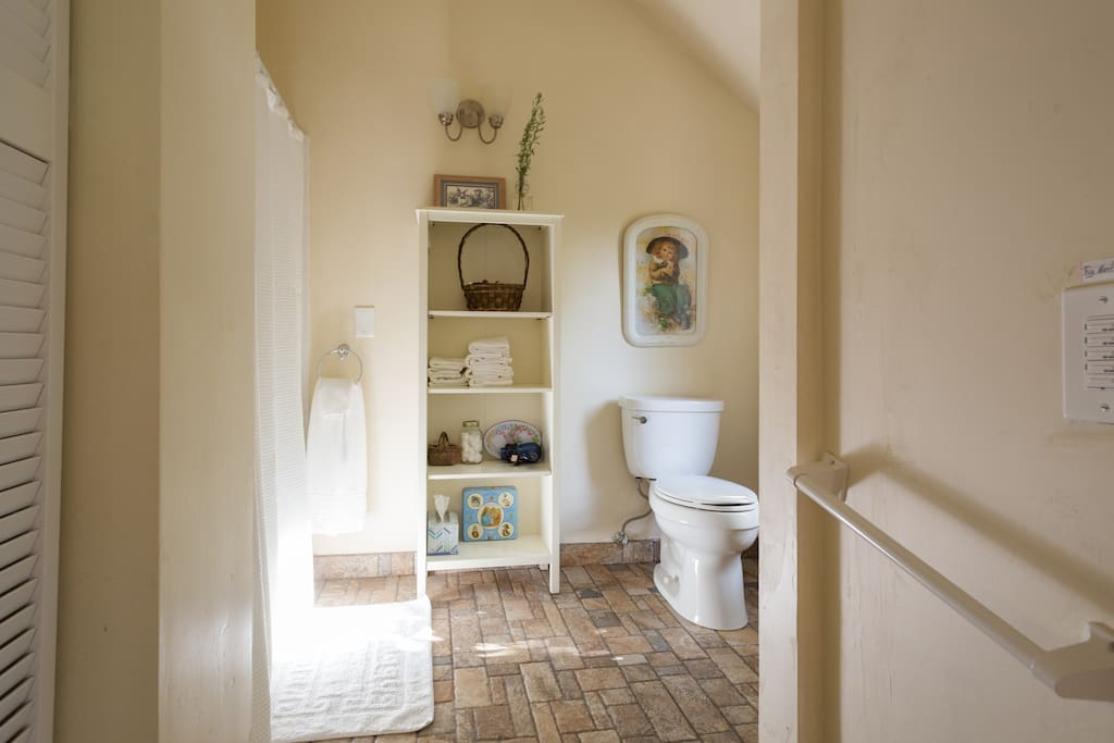 Large full bathroom with amenities and soft towels.