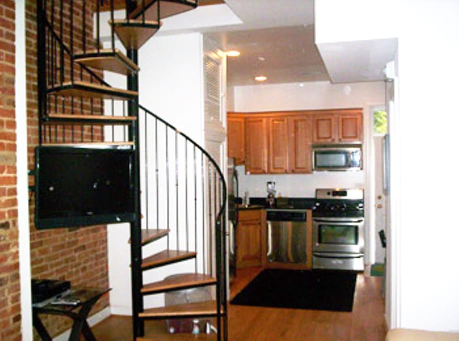 Pc163 modern 2 story loft w spiral stairs apartments for Two story spiral staircase