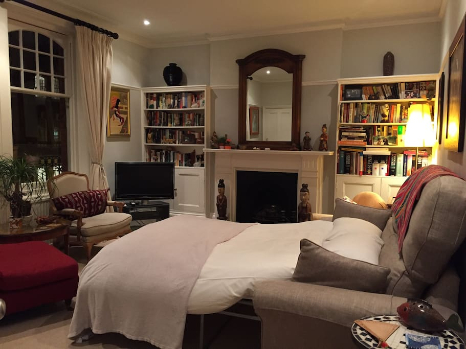 The living Room converted to a stylish bedroom.