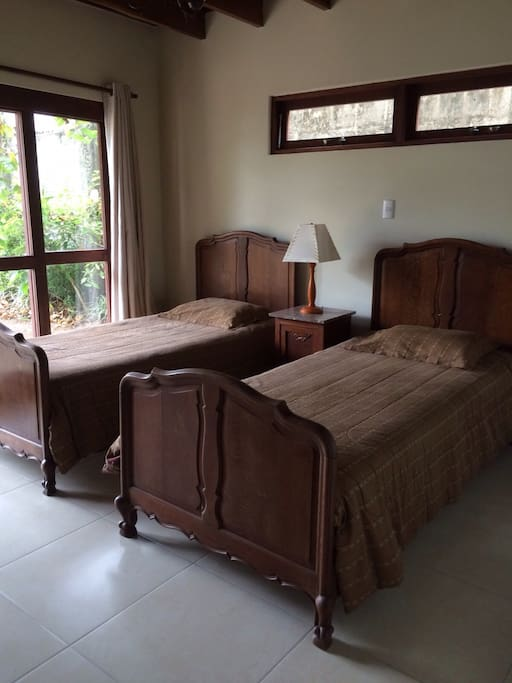 Bedroom with twin beds and sliding glass doors to patio