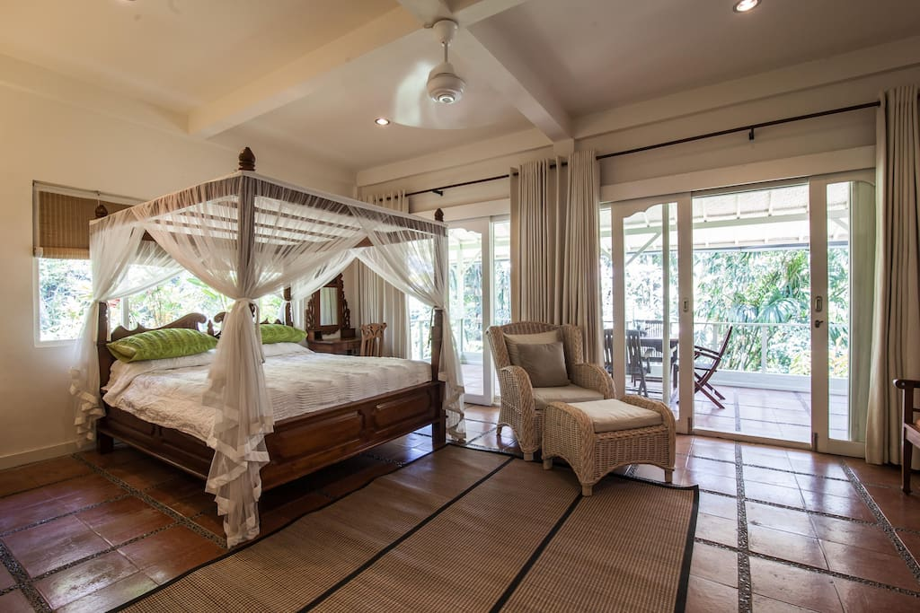 Master Bedroom with 4 poster king size bed and mosquito net