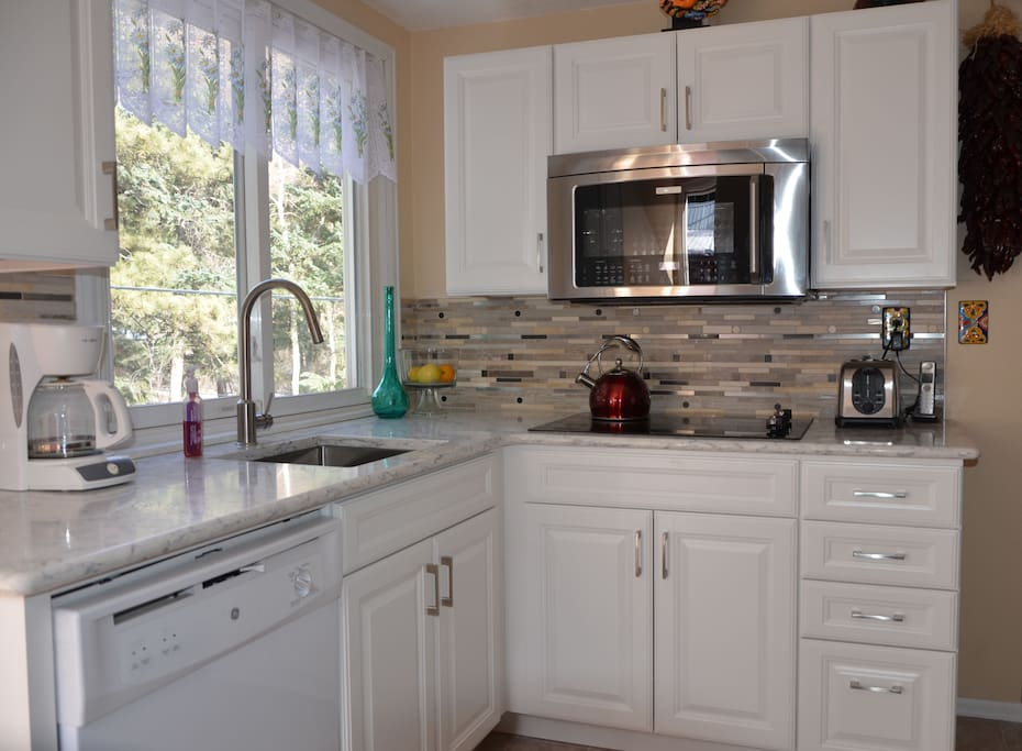 The newly remodeled kitchen with microwave / convection oven.