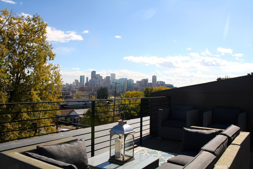 Incredible rooftop views and lounge seating/dining area with grill