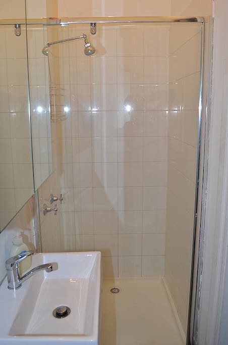 Spotless modern bathroom with a rimless showerscreen inside the room. It's private and all yours!