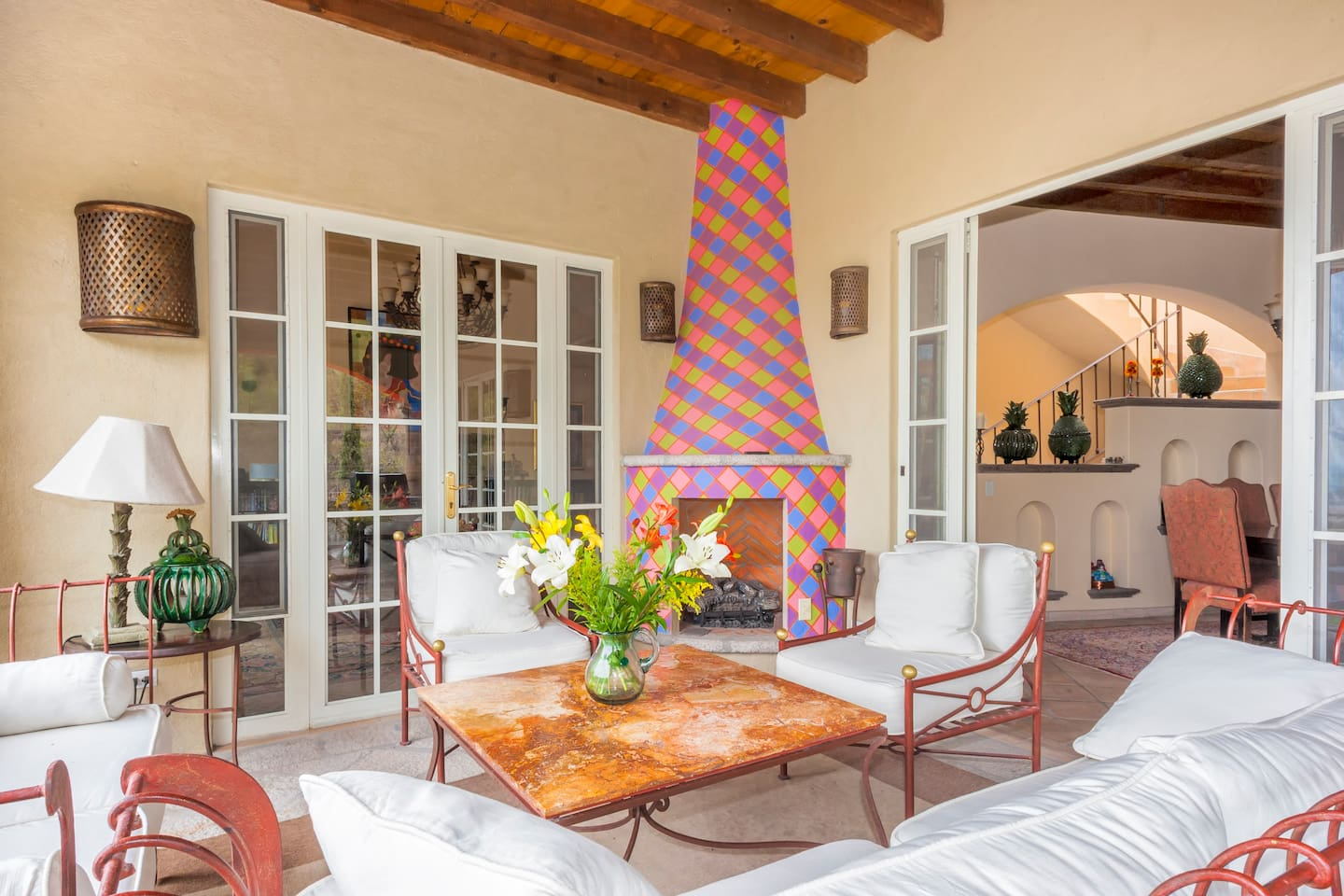 At Casa Colina, we spend most of our time here. A seating area with fireplace, outside, but next to the kitchen