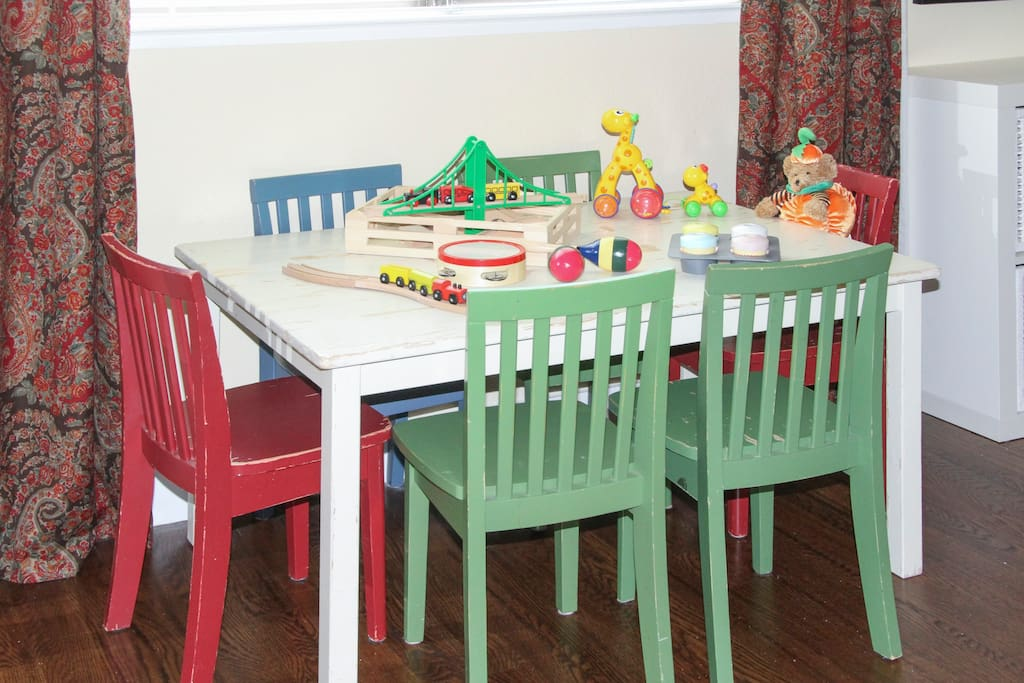 Kids table with toys to keep the young ones occupied.