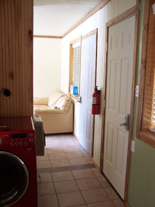 Hall way to living area, washer and dryer