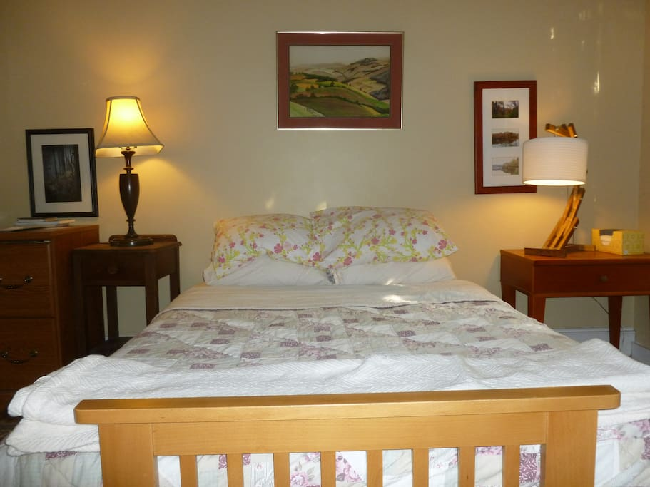 Two bedside tables, each w/ a drawer, lamp & power strip.