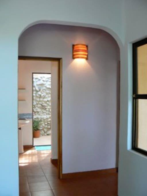 Hallway to bath and outdoor/indoor shower