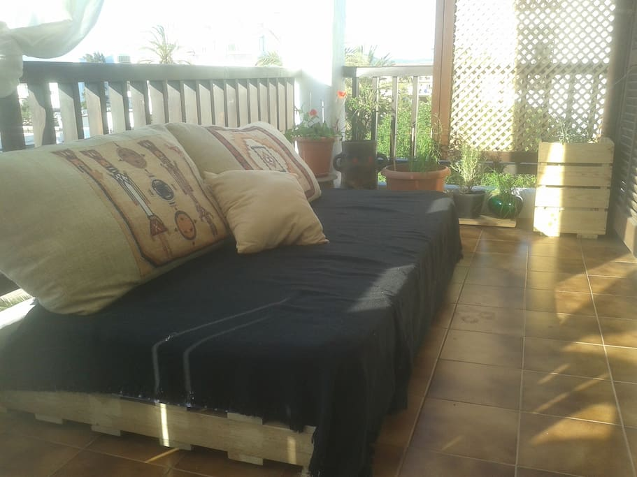 Chill-out with day-bed and herb garden.