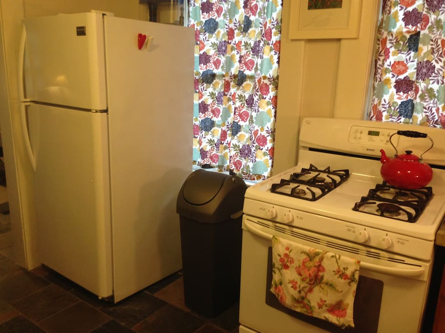 The Wagewood kitchen contains a full-size refrigerator, gas stove, and quality Simple Human trash can with a swingin' lid!