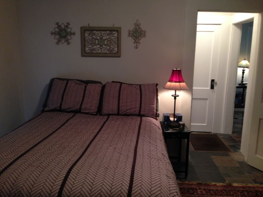 The full size bed comfortably sleeps two. The bedroom also contains a closet and ample dresser.