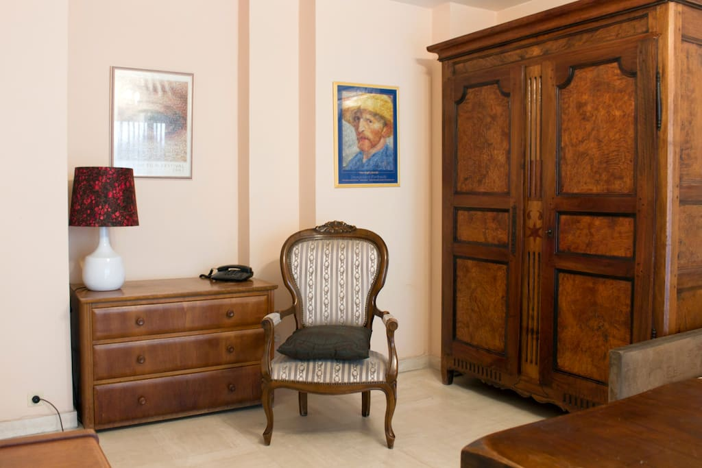 Living room with chest of drawers, armoire and antique chair