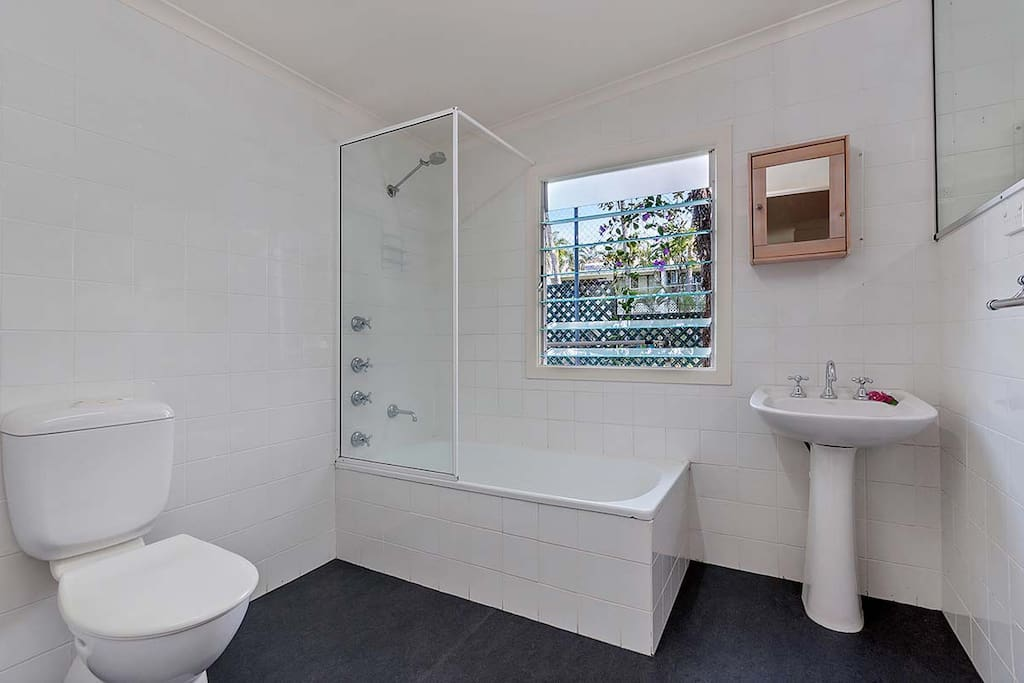 Bathroom Ensuite has shower over bath, toilet and vanity. Large Mirror, hairdryer, fresh white towels provided