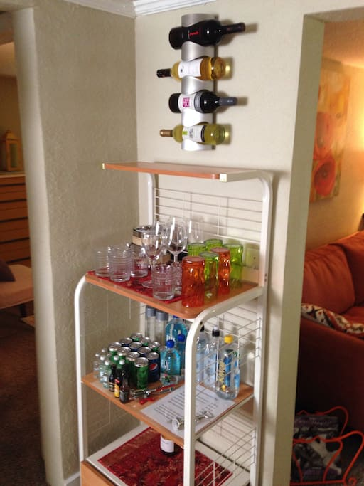 Nicely stocked honor bar with a selection of wines, bottled water,spirits and mixers.