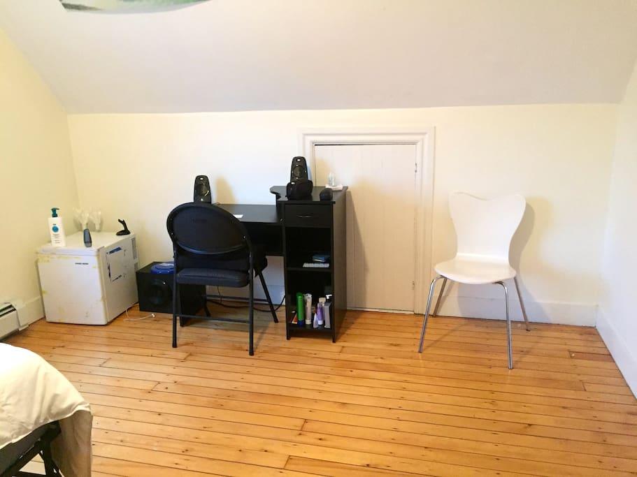 Spacious room with mini-fridge and small desk
