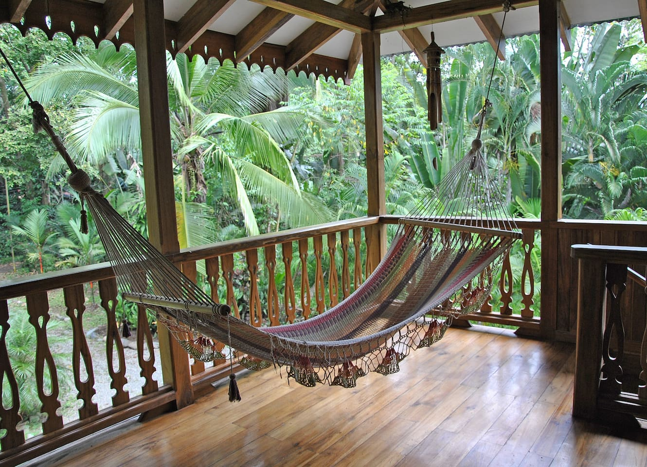 balcony with hamock and view in the Tropical garden