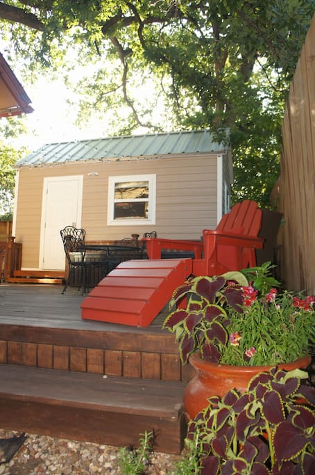 Welcome to the Tiny House! Shaded deck area with seating.