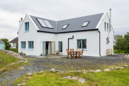 This large detatched family holiday home, set on 3/4 acres, is situated in the heart of Connemara - the gateway to the West.  The cottage has been built to exceed modern building standards, having been re-designed with family living in mind.
