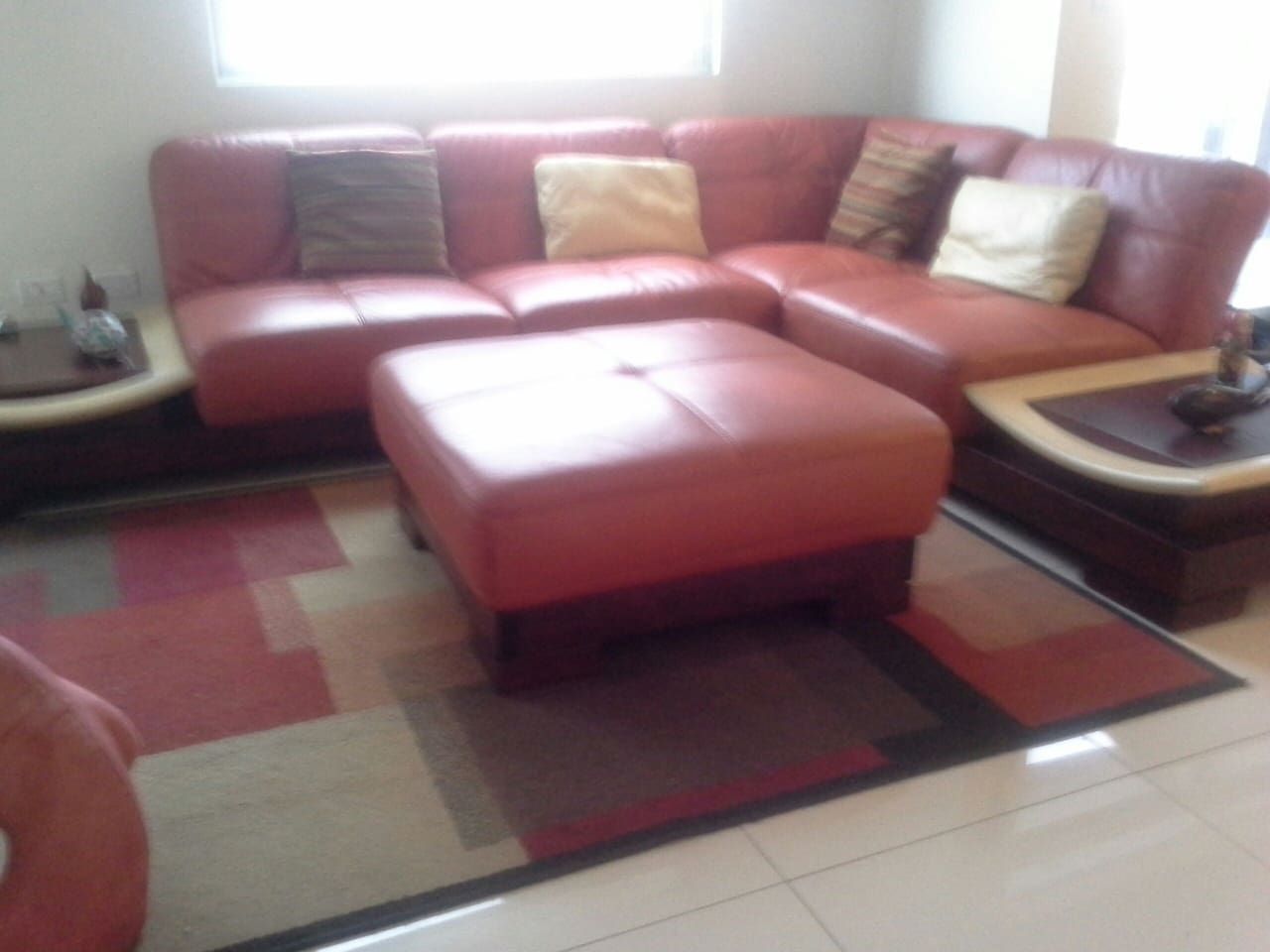comfortable living room with nice leather couch and good lighting.