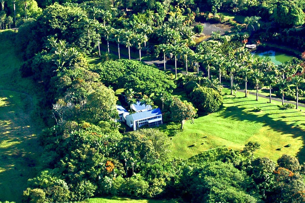 Aerial View.  The Grand Suite is the entire main house... the large section of house in the foreground.   Owners remain on premises in cottage behind house.