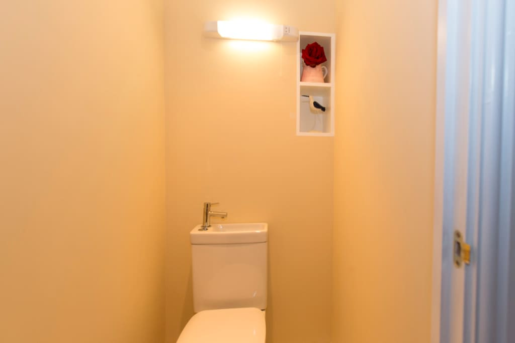 The room is next to a small lavatory