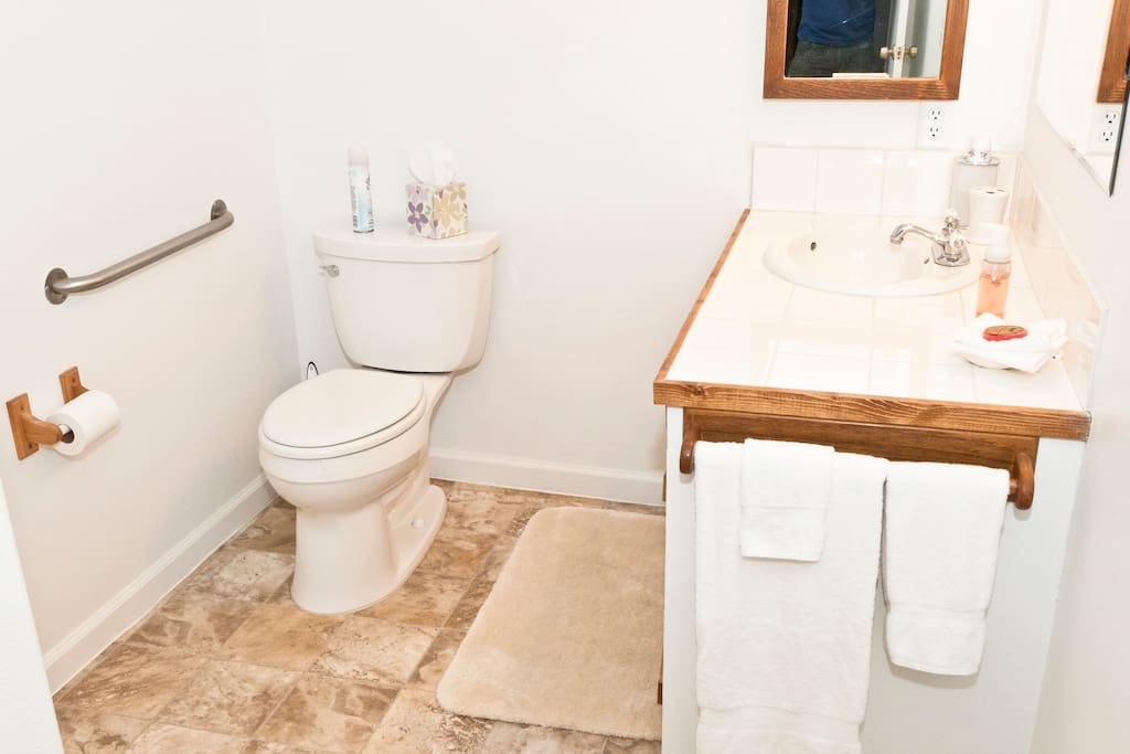 Sunrise bathroom is light n bright. Stall shower, commode, sink & stocked with amenities.