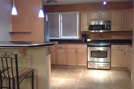 Garden Level Executive Midtown Anchorage Condo - Anchorage