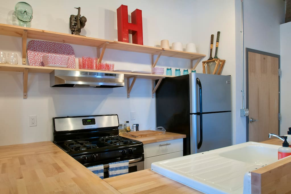 Kitchen area with lots of counter space and new appliances.