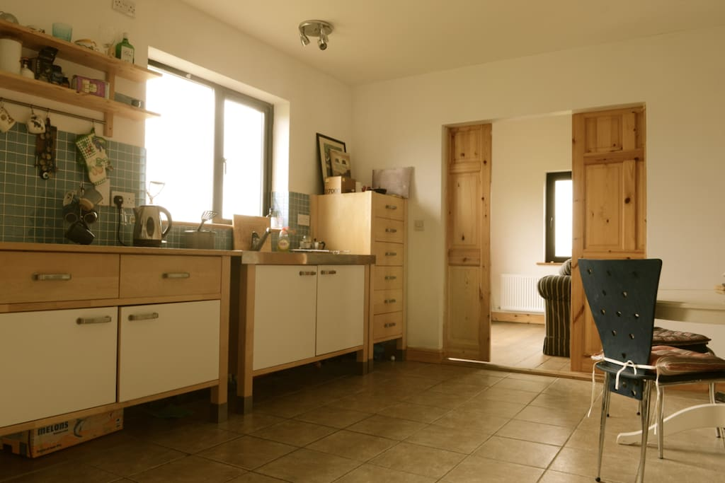 Large bright spacious kitchen that opens on to living space.