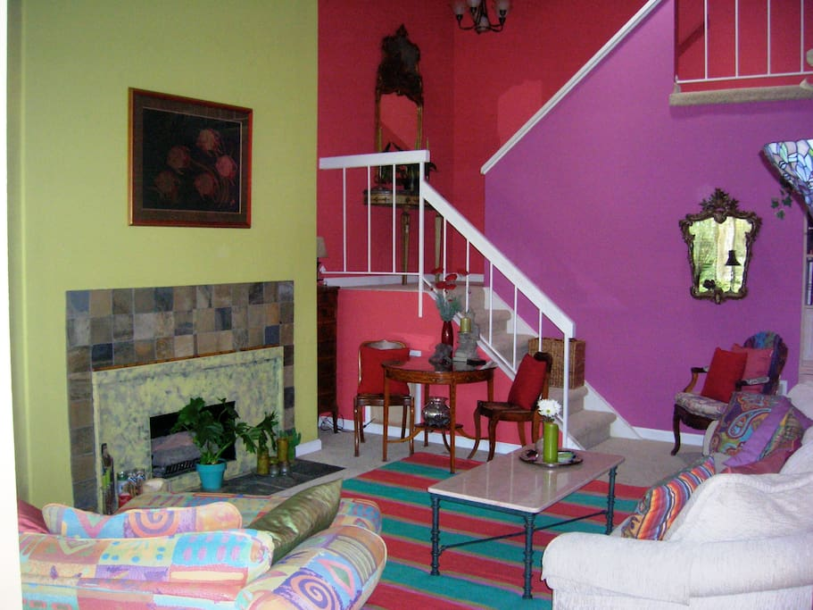 the colorful living room with bedrooms upstairs.