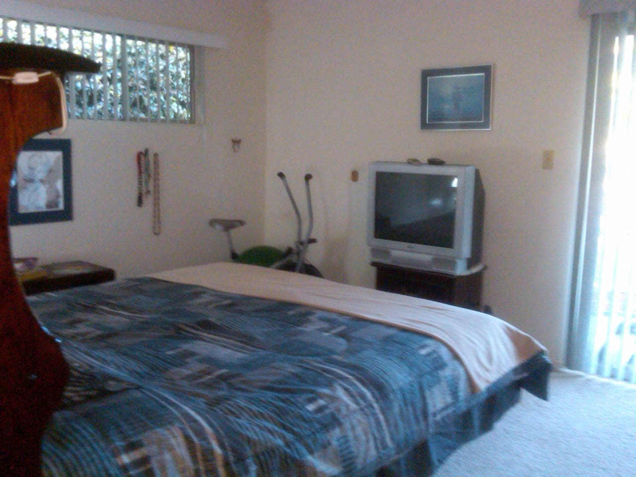 Private room with private entrance and private bathroom with CalKing sized bed.