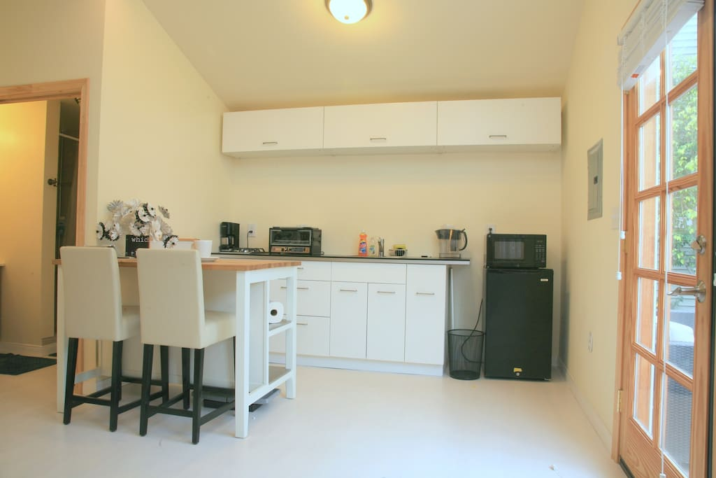 Kitchenette has mini fridge, two burner stove top, microwave oven,  and small toaster oven. All dishes and cookware provided.