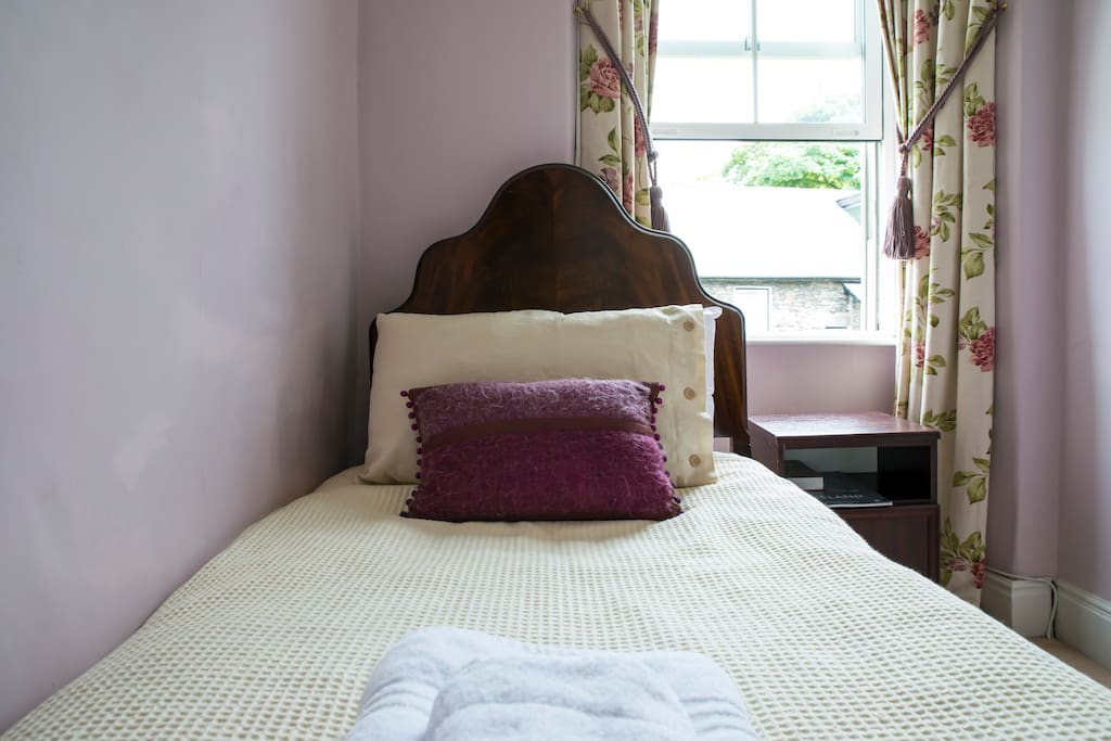 Brantfell is a is a longish room with a single bay window that looks out over Old Bowness and north to Lake Windermere and the fells beyond.