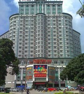 广西北海公寓一室凤凰树商务酒店大床房、40寸大电视、wife覆盖 - Beihai - Lägenhet