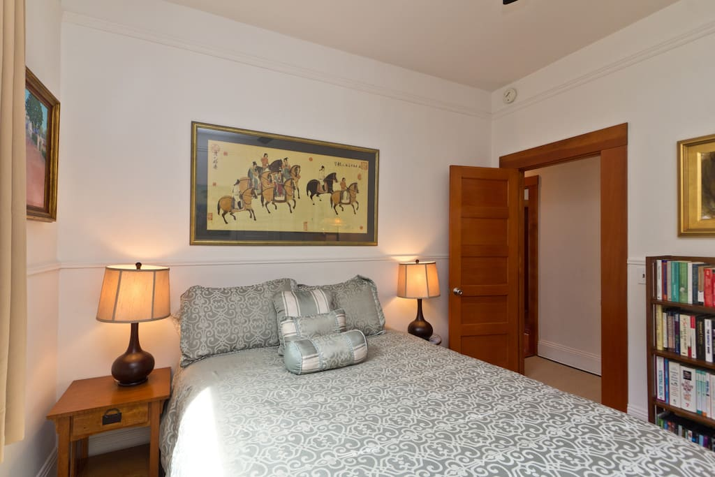 The queen size bedroom is cosy with an organic cotton and bamboo mattress, and decorated with original artwork.