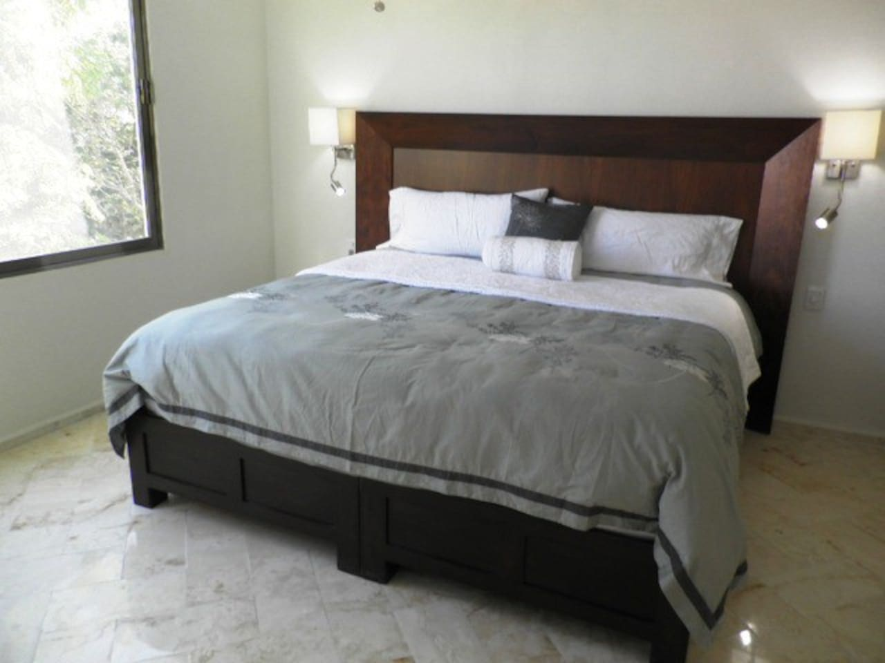 The 4th floor master suite features a king-size tzalam wood headboard and 1,000 thread count sheets.