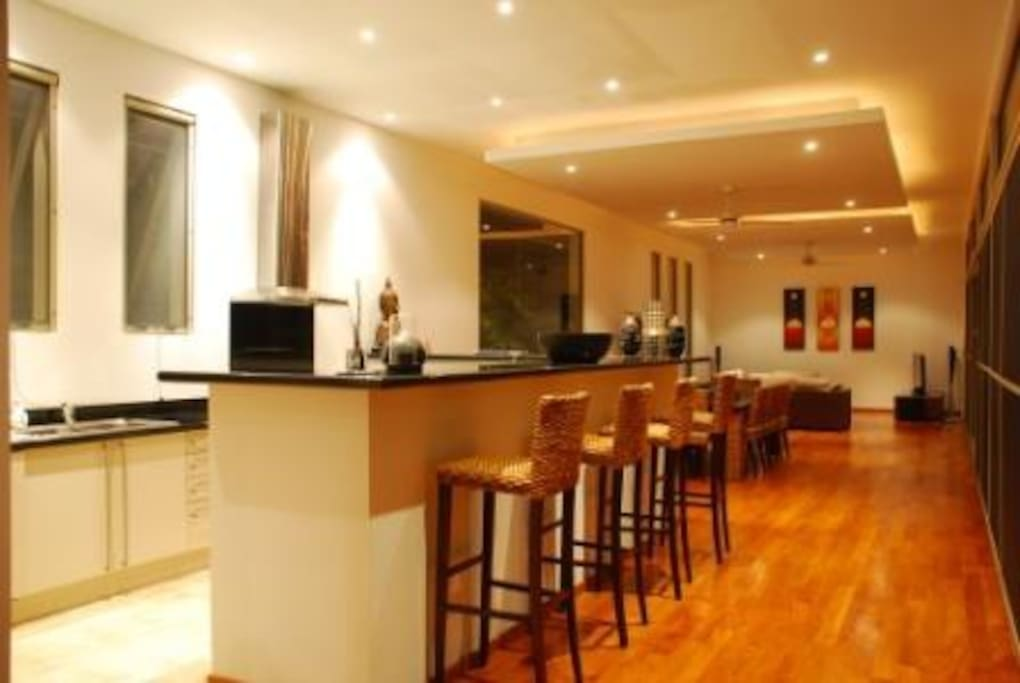 Open plan kitchen, dinning and living room fully air-conditioned opening onto our large pool terrace area