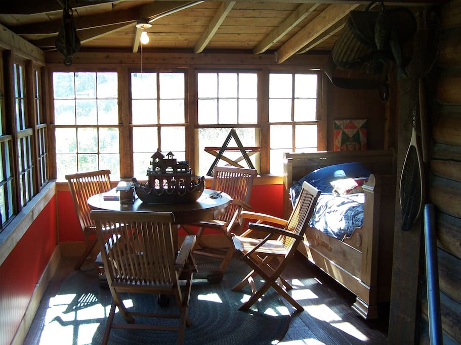 Another view of enclosed porch, another bed