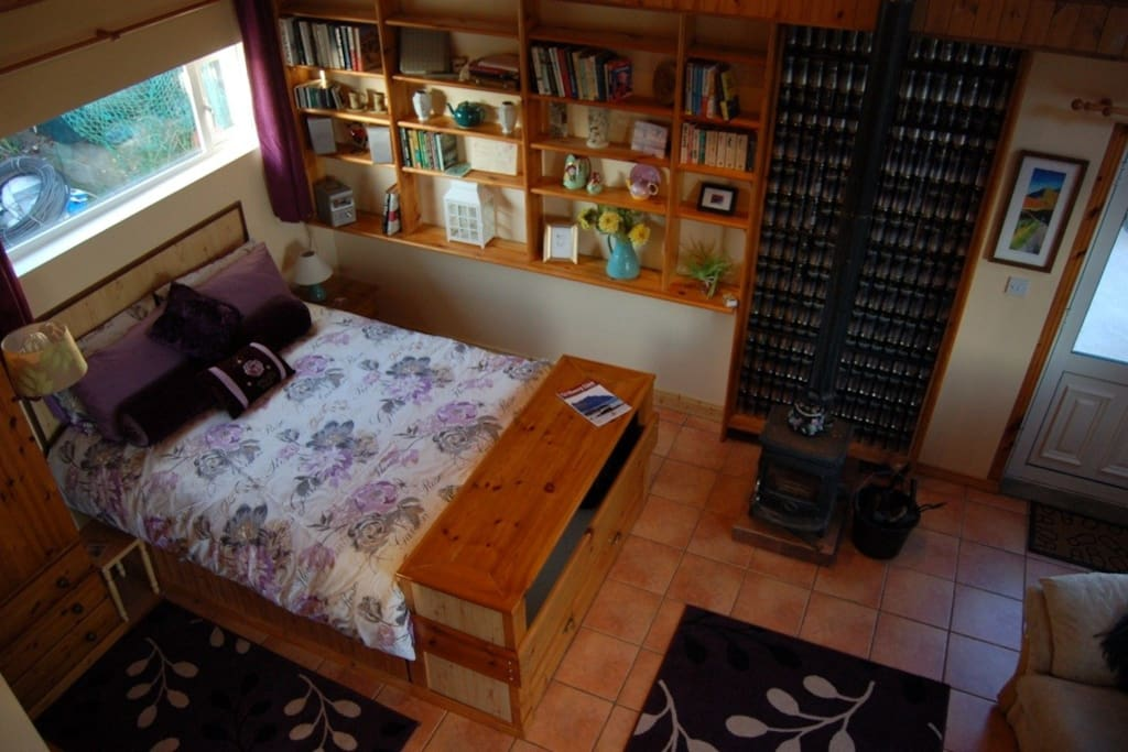 View of the king size bed from the loft area
