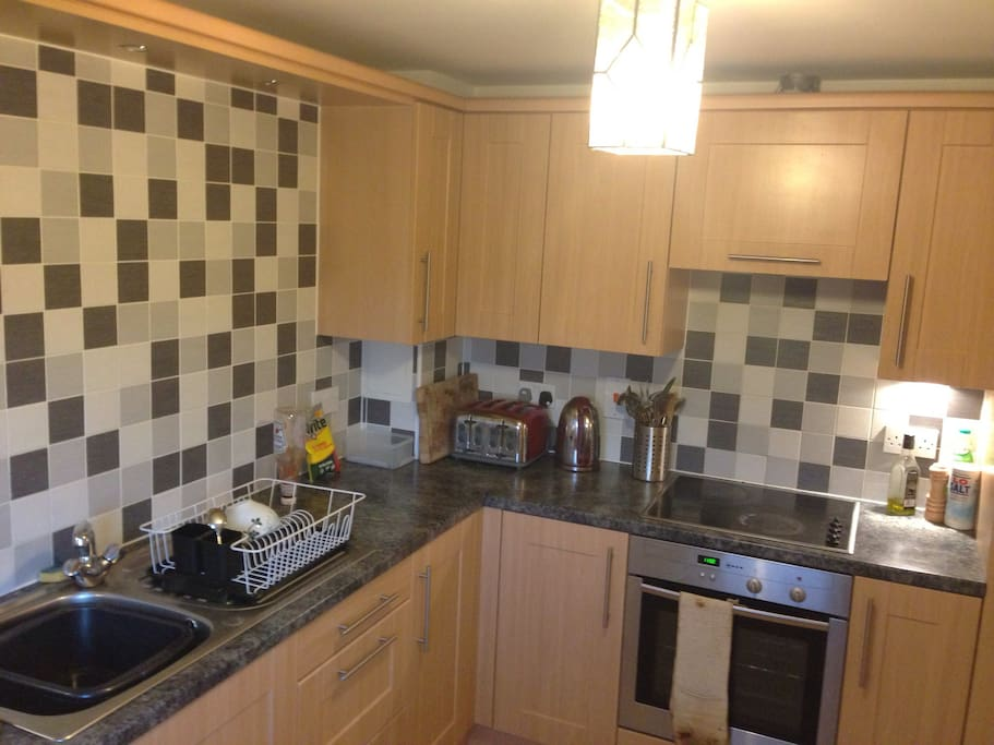 Modern kitchen which you're welcome to cook in and help yourself to breakfast and soft drinks.