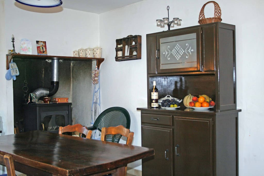 Kitchen with wood stove for atmosphere - there is a gas stove for cooking, kettle, toaster plus modern heaters in every room