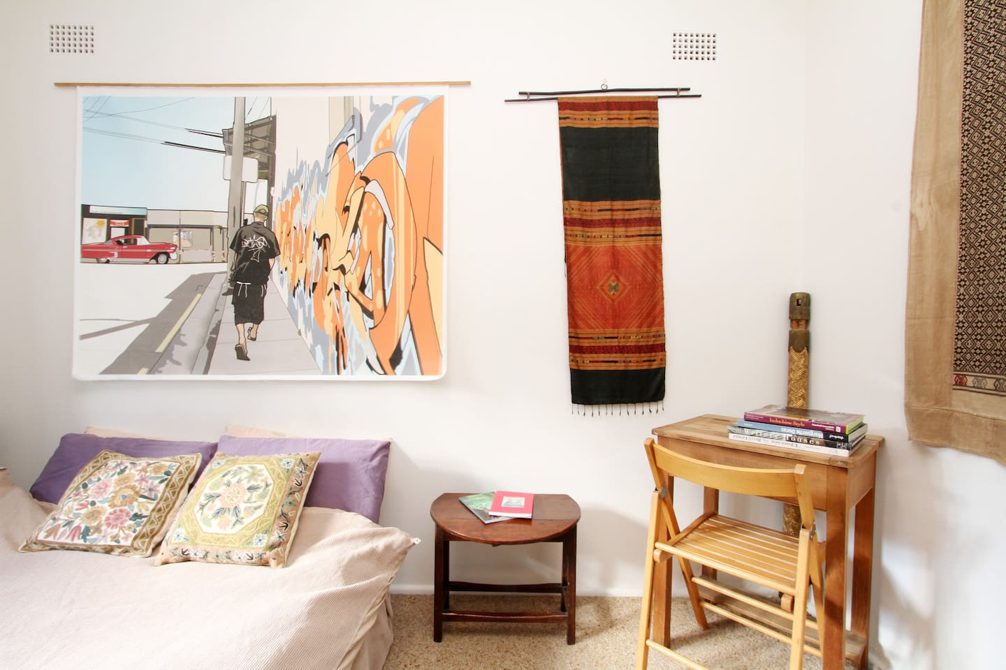 Your comfy bedroom, decorated with local art and wall hangings from my travels.