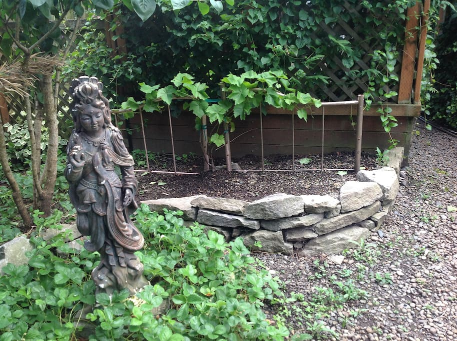 Kwan Yin and grapevines also welcome you.