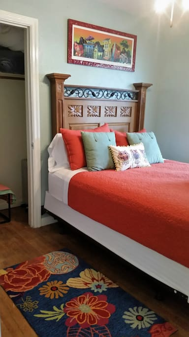 Room 2- Queen Size Pillow top bed. Very comfortable. Also lots of light from a large window with a ceiling fan and light.