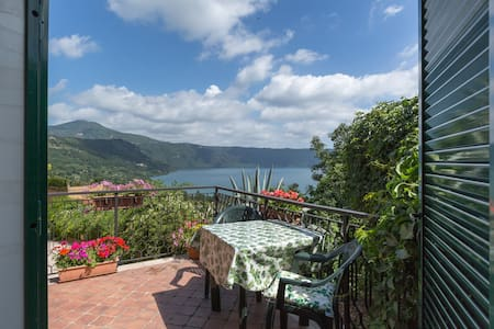 Easy reach of central Rome, this little jewel looks onto Lake Albano near the pretty village of  Castel Gandolfo and the Pope's summer residence. Hourly trains to Roma Termini. A family condominium inhabited  by commuters to Rome - no tourists!